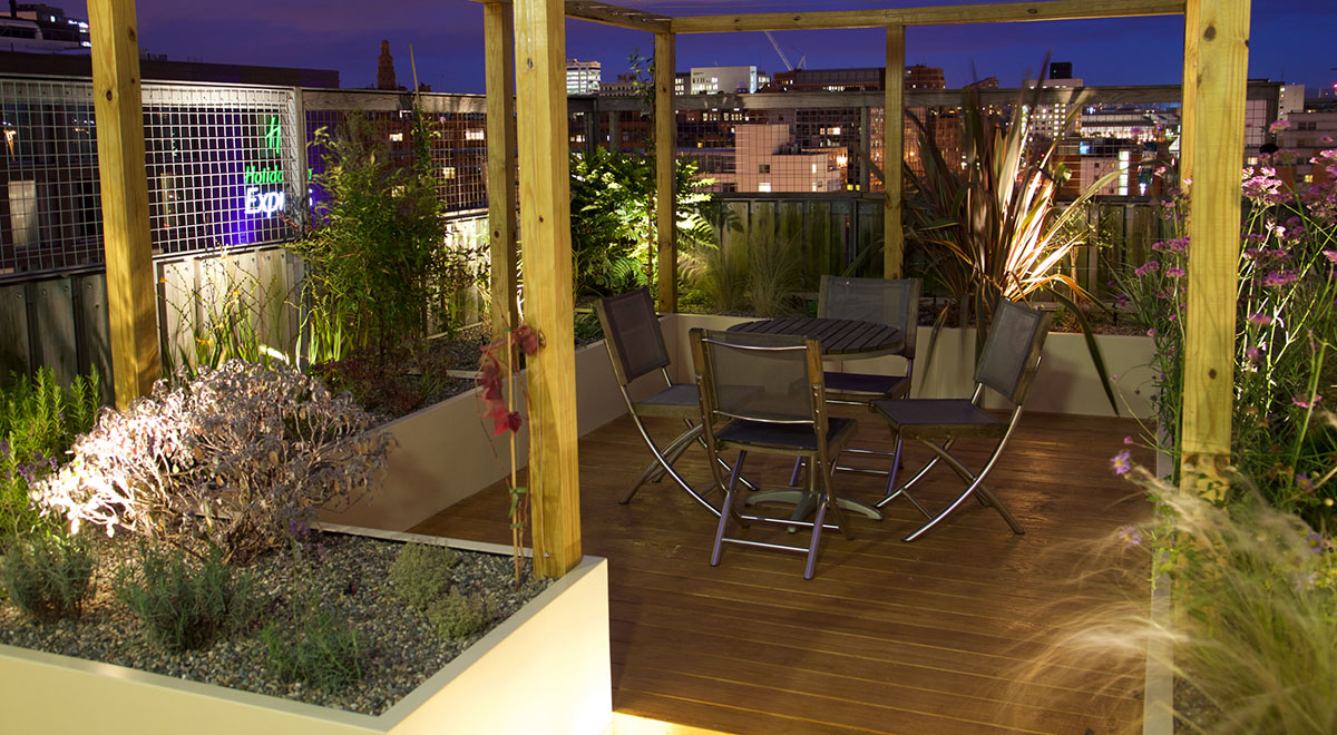 Gardener's Roof Terrace Incorporates Southern Yellow Pine Decking, Pergola and Bespoke Seating