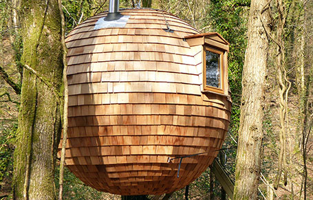 Western Red Cedar Shingles Convert a Floating Pod With a Flawed, Leaky Exterior Into a Remarkable Natural Glamping Getaway