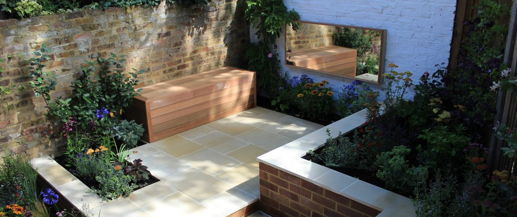 Cedar and Mirrors Make Small Garden Feel Larger