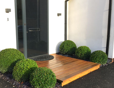 Decking Creates a Stylish Entrance to Contemporary Build