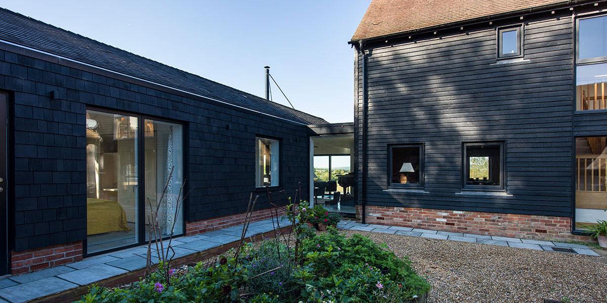 Black Cedar Shingles Feature On Carbon Negative Modern Barn Conversion